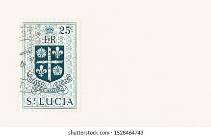 SEATTLE WASHINGTON - October 5, 2019: Definitive 25c stamp of St Lucia,with coat of arms and motto - Statio Haud Malefida Carinis. Scott #166 stamp with copy Space.