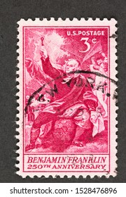 SEATTLE WASHINGTON - October 5, 2019: Red 3 cent USA postage stamp featuring likeness of Benjamin West's painting of Benjamin Franklin Drawing Electricity from the Sky, issued in 1956. Scott # 1073.