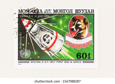 SEATTLE WASHINGTON - October 5, 2019: First living being to go to space, Russian dog Laika, in 1957 on Sputnik 1, commemorated on Mongolia postage stamp.