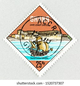 SEATTLE, WASHINGTON - September 25, 2019: Close up of Ghana postage stamp, featuring a Spanish Galleon and Cape Coast  Castle. Castle theme postage  issued in 1967. Scott # 304