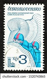 SEATTLE, WASHINGTON - September 25, 2019: Close up of 4 man Bobsled team on Czechoslovakia commemorative postage stamp, issued in 1980, celebrating the Lake Placid Olympics in USA.