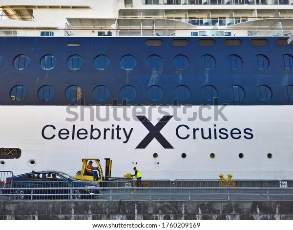 SEATTLE, WASHINGTON - SEPTEMBER 3, 2018: Celebrity Cruises logo on the side of the Celebrity Infinity cruise ship as workers prepare the ship to leave port.  Celebrity is owned by Royal Caribbean.