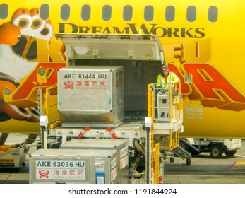 SEATTLE, WASHINGTON STATE, USA - JUNE 2018: Air freight pallet being loaded into the cargo hold of a Hainan Airlines Boeing 787 Dreamliner at Seattle Tacoma airport.