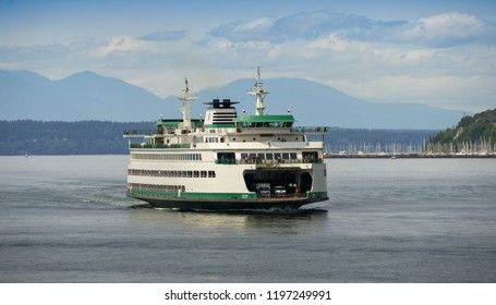 SEATTLE, WASHINGTON STATE, USA - JUNE 2018: Large passenger and car ferry arriving in Seattle after crossing Puget Sound.
