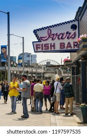 SEATTLE, WASHINGTON STATE, USA - JUNE 2018: People queuing outside Ivans Fish Bar on the waterfront in Seattle.
