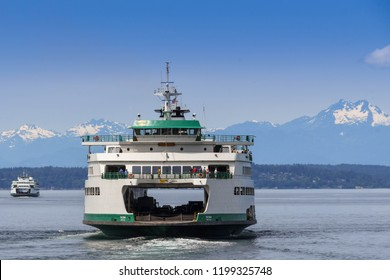 SEATTLE, WASHINGTON STATE, USA - JUNE 2018: Large passenger and car ferry leaving Seattle to cross Puget Sound.