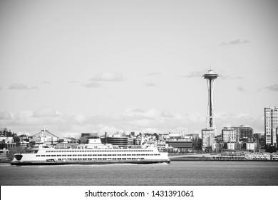 Seattle, Washington United States - February 26, 2019. Black and white Seattle Washington city space needle with ferry boat.