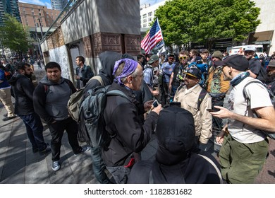 Seattle, Washington / United States - May 1 2018: Tensions rise as members of both left and right-wing groups meet at Seattle's Westlake District during the May Day rallies.