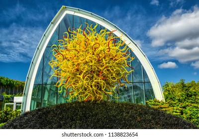 Seattle, Washington, US.  September, 13, 2017    Glass house and sculpture Chihuly Glass Museum at the Seattle Center and space Needle.