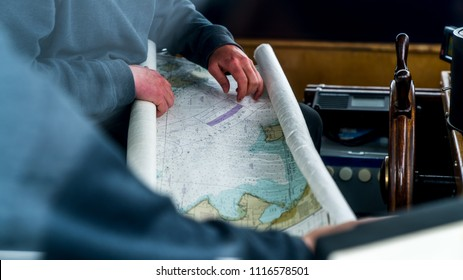 Seattle, Washington - USA. 29. 07. 2017. Sailor looking on the map, pointing on a certain area towards navigating there. The Evergreen State. Whatcom County, Washington, USA.