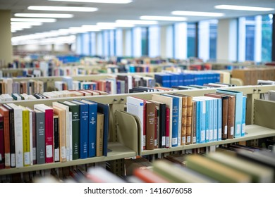 Seattle, Washington / USA - April 5 2019:  Stacks of books in the Suzzallo Allen Library at the University of Washington (UW), in an academic background
