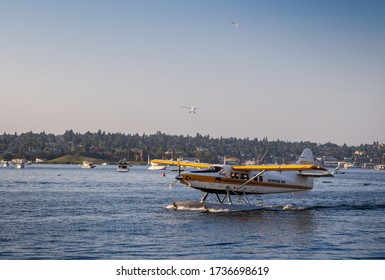 Seattle, Washington / USA - August 17th 2018: a shot of a Kenmore Air operated seaplane taking off from Lake Union taken from Westlake looking towards eastlake in Downtown Seattle