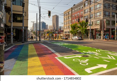 Seattle, Washington / USA - August 18th 2018: a shot of a gay pride rainbow crosswalk and a green bike lane along Broadway and Pine Street in the Capitol Hill neighborhood district in Seattle