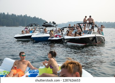 Seattle, Washington / USA - August 6 2017: Boaters partying on luxury speed boats in Lake Washington during Seafair Weekend
