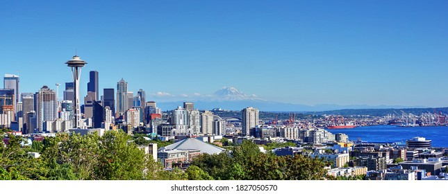 Seattle, Washington / USA - August 7, 2015: The Seattle City skyline rises above Elliot Bay as Mount Ranier floats on the horizon.