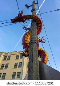 Seattle, Washington, USA Chinatown colorful dragon wrapped around a wooden pole at the entrance to Chinatown and the International district.