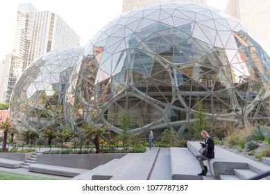 Seattle, Washington USA circa April 2018 The Amazon World Headquarters Campus Spheres terrariums afternoon light in spring season showing employee working outside.