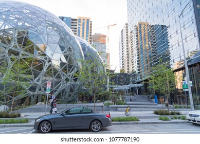Seattle, Washington USA circa April 2018 The Amazon World Headquarters Campus Spheres terrariums afternoon light in spring season showing parked convertible car with people walking by.