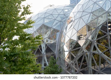 Seattle, Washington USA circa April 2018 The Amazon World Headquarters Campus Spheres terrariums afternoon light in spring season showing trees growing outside windows.