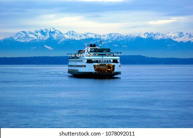 Seattle, Washington / USA - Dec. 30, 2006: The Bremerton - Seattle ferry at dusk with the Olympic Mountains in the background.