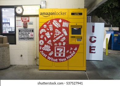 SEATTLE, WASHINGTON, USA - DECEMBER 15, 2016: Amazon Locker Package Delivery Machine Located Outside of a 7-11 Store, an Alternative Method of Receiving Packages
