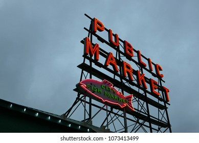 Seattle, Washington, USA - December 29, 2017: Public Market neon sign against cloudy evening sky