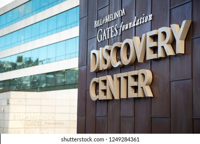 """Seattle, Washington / USA - December 3 2018: """"Bill and Melinda Gates Foundation Discovery Center"""" sign on the exterior of the philanthropic headquarters building, with space for text on the left"""
