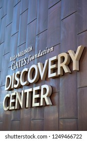 """Seattle, Washington / USA - December 3 2018: """"Bill and Melinda Gates Foundation Discovery Center"""" sign on the exterior of the philanthropic headquarters building in Seattle, with space for text on top"""