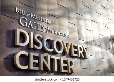"""Seattle, Washington / USA - December 3 2018: """"Bill and Melinda Gates Foundation Discovery Center"""" sign on the exterior of the philanthropic headquarters building in Seattle"""