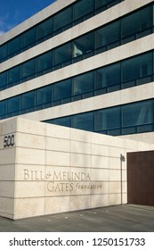 """Seattle, Washington / USA - December 3 2018: """"Bill and Melinda Gates Foundation"""" sign on the exterior of the philanthropic headquarters building in Seattle, with space for text on top"""