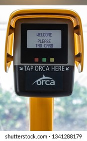 Seattle, Washington / USA - February 27 2019: Digital payment terminal and Orca Card reader at a Sound Transit Light Rail Station