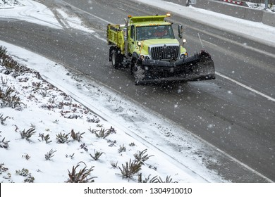 Seattle, Washington / USA - February 4 2019: Snowplow on State Route 99 Tunnel during a winter snow storm, with space for text on the bottom