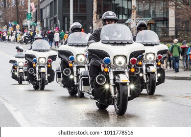 Seattle, Washington / USA - January 20, 2018: Women's March. Motorcycle police Escort the first group of marchers.
