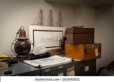 Seattle Washington, USA. January 7,2020. North West Seaport maritime heritage museum's office artifacts. Two boxes with sextants, navigation lights, and a drawing of the the Arthur Foss tugboat.