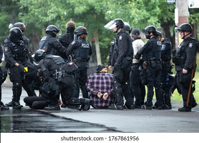 Seattle, Washington / USA - July 1 2020: Protesters under arrest by Seattle Police clearing the Capitol Hill Occupation Protest (CHOP)