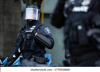 Seattle, Washington / USA - July 1 2020: Seattle Police in a riot helmet while clearing the Capitol Hill Occupation Protest (CHOP)