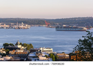 Seattle, Washington, USA - July 2,2017 : Seattle cityscape overlooking the Cosco container cargo ship and Harbor Island as seen from Kerry park viewpoint, Seattle, Washington, USA.