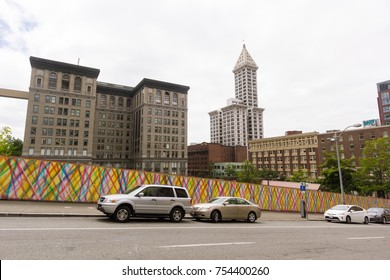 Seattle, Washington, USA - July 2,2017 : Cars parked in a steep street with a vintage building background in downtown seattle, Washington, USA