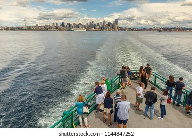 Seattle, Washington, USA - July 7, 2018: Passengers on a Washington State Ferry boat crossing to Bainbridge Island, Seattle, Washington, USA