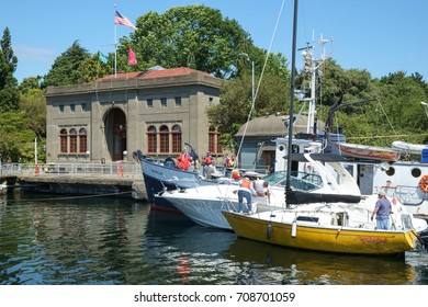 SEATTLE, WASHINGTON, USA JULY 7, 2017: Boat owners working to tie boats together in preparation to be lowered in the Hiram M Chittenden Locks (Ballard Locks) in Seattle, Washington
