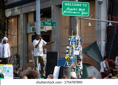 Seattle, Washington / USA - June 10 2020: Protesters speaking in front of the abandoned Seattle East Precinct Police Station in the Capitol Hill Autonomous Zone (CHAZ)