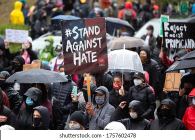 """Seattle, Washington / USA - June 12 2020: """"Stand Against Hate"""" protest sign at the March of Silence demonstration"""
