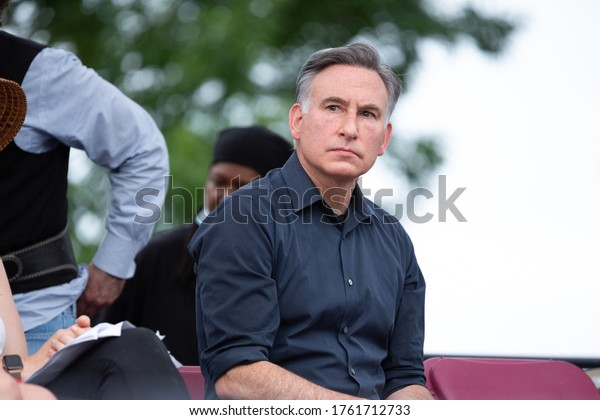 Seattle, Washington / USA - June 19 2020: King County Executive, Dow Constantine, listening to remarks at a public event