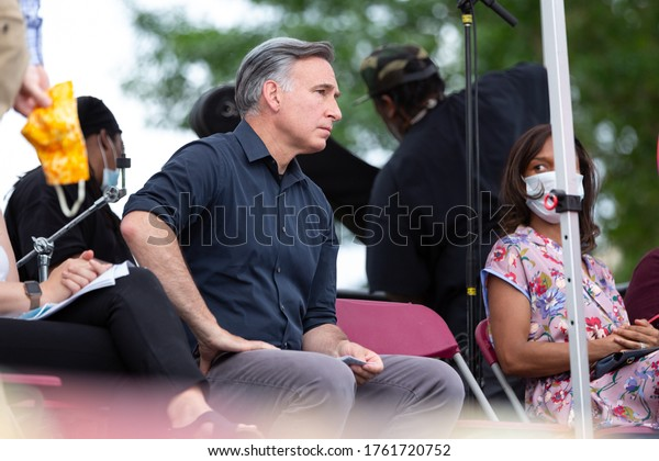 Seattle, Washington / USA - June 19 2020: Dow Constantine listening to remarks at a Juneteenth event