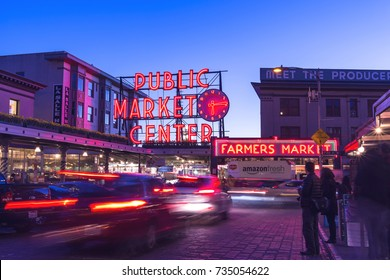 Seattle, Washington, USA - March 1, 2015_Public Market Center at twilight. It is an old continually operated public farmers' markets in the United States, long exposure technic for car light trails