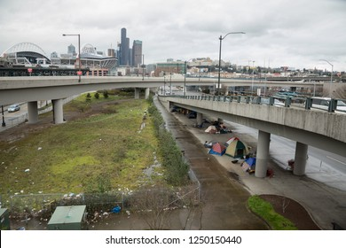 Seattle, Washington / USA - March 11 2017: Wide angle view of homeless encampments and tents sheltered from the rain under freeway overpasses in downtown Seattle