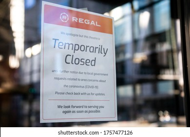 "Seattle, Washington / USA - March 16 2020: ""Temporarily Closed"" sign at a Regal Cinemas movie theater during the COVID-19 shutdown"