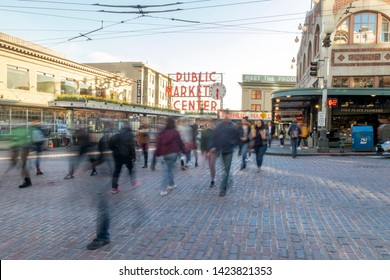 Seattle, Washington, USA / March 2019: Long exposure photo of people crossing the street in front of Public Market Center on 1st Avenue and Pike Place in downtown Seattle.