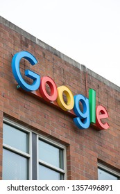 Seattle, Washington / USA - March 27 2019: Google sign on the corner of the Alphabet offices in Seattle's Fremont neighborhood, with space for text on top and bottom