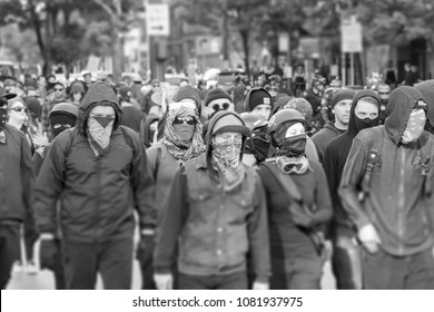 Seattle, Washington USA May 1st 2018 The annual May Day protests held downtown, violent Antifa members marching with masks covering their faces in black and white.